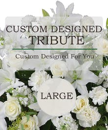 A custom traditional sympathy tribute basket