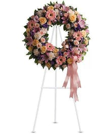 A timeless wreath featuring gerbera daisies, roses & more